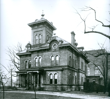 image of house with building in background