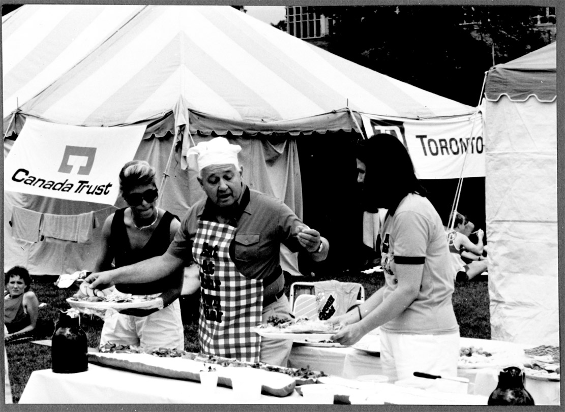 man with chef's hat serves bbq food at the Run for the ROM