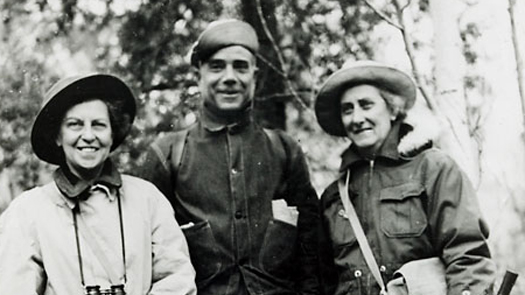 three people outdoors with excavation tools