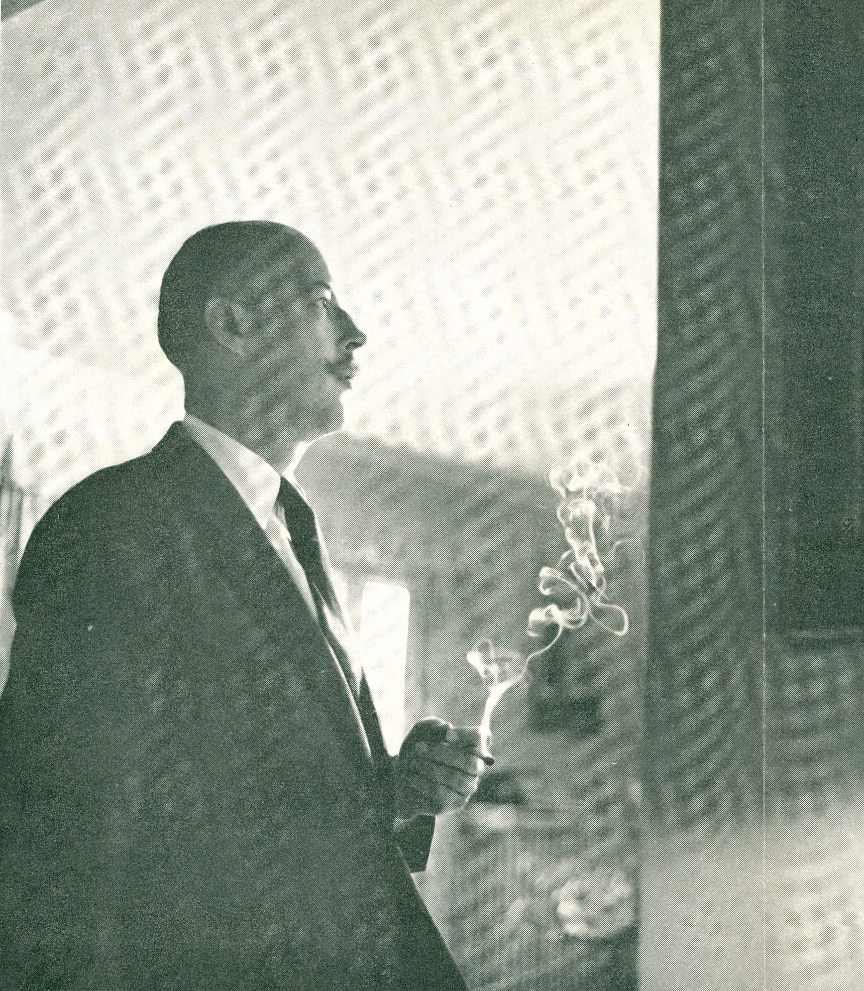 Heinrich with cigarette in profile