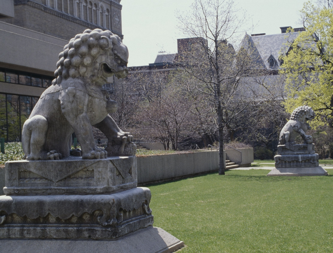 sculpture of lions on lawn