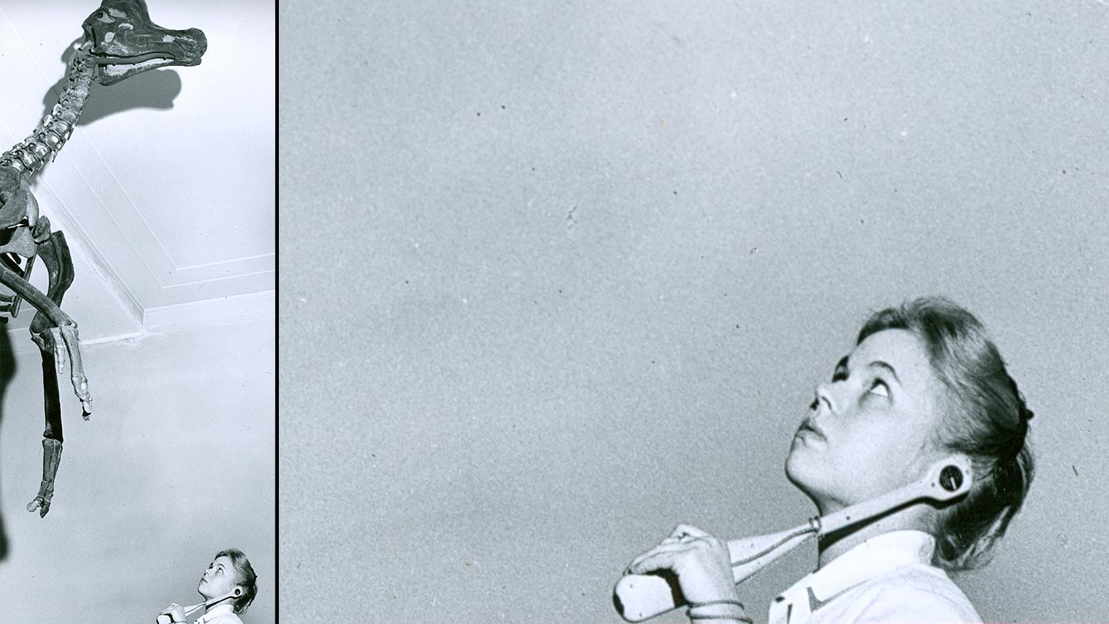 girl listening to handheld radio device in gallery