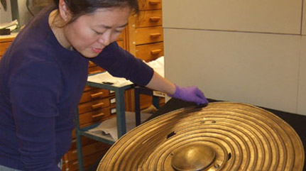 Re-seating a rare Bronze Age shield in collections storage