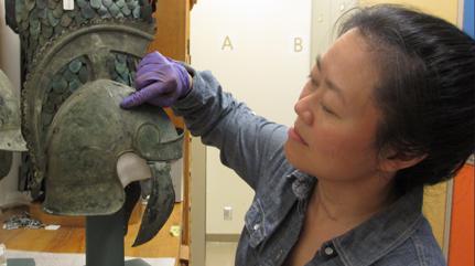 Examining a helmet for the Fact or Falsehood display