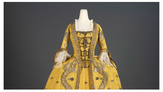 Rotations of objects, such as beautiful gowns, invite visitors to return regularly.