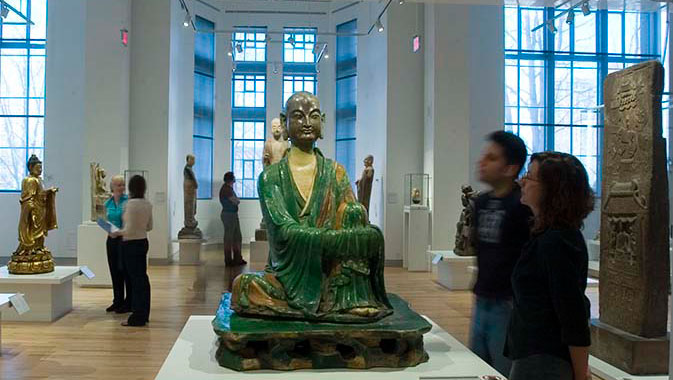 A green glazed ceramic Yizhou Luohan statue from the 10th century sits serenely at the gallery's entrance.