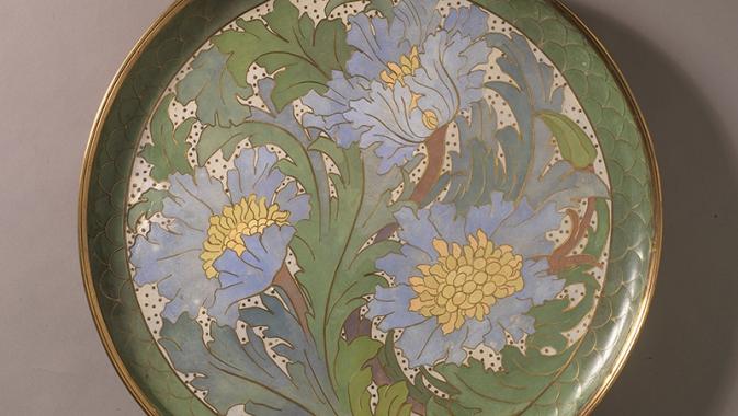 Large charger embellished with floral illustration.