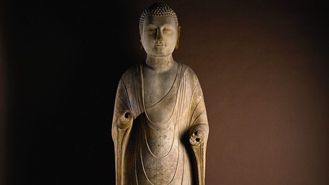 Three-metre tall 6th century marble standing Buddha.