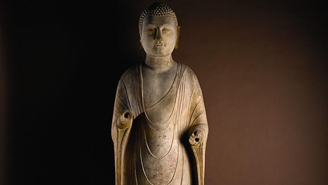 Three-metre tall 6th century marble standing Buddha.