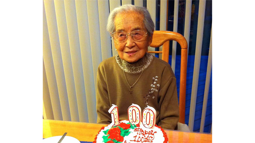 woman with 100th birthday cake