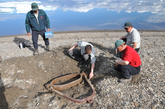 Parks Canada archaeologists excavating a rigging element from HMS Investigator