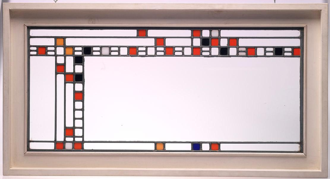 Stained glass panel by Frank Lloyd Wright Designed in 1912 for the Avery Coonley Playhouse,  Clear and coloured glass, lead latticing, wood 2000.22.3   Gift of the Louise Hawley Stone Charitable Trust; Purchased by the ROM with the assistance of a Moveable Cultural Property grant accorded by the Minister of Canadian Heritage under the terms of the Cultural Property Export and Import Act.
