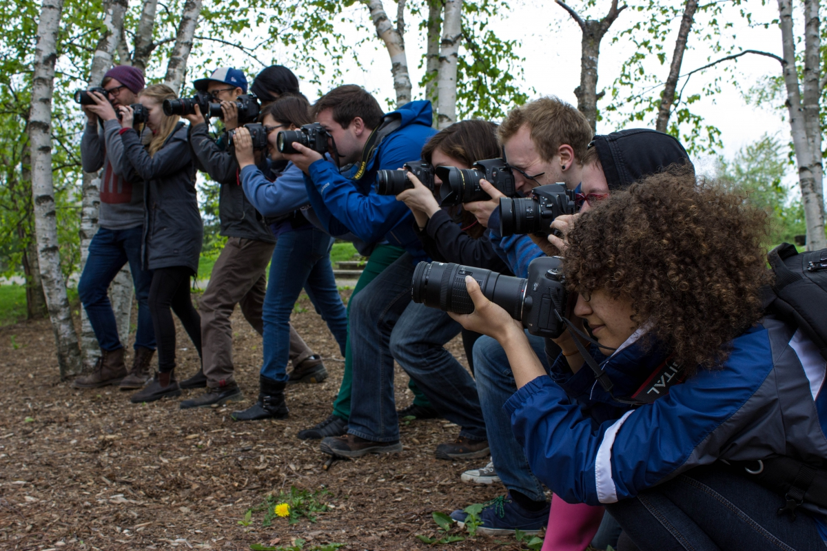 A dozen students aim their cameras in anticipation of some exciting Bioblitz action!