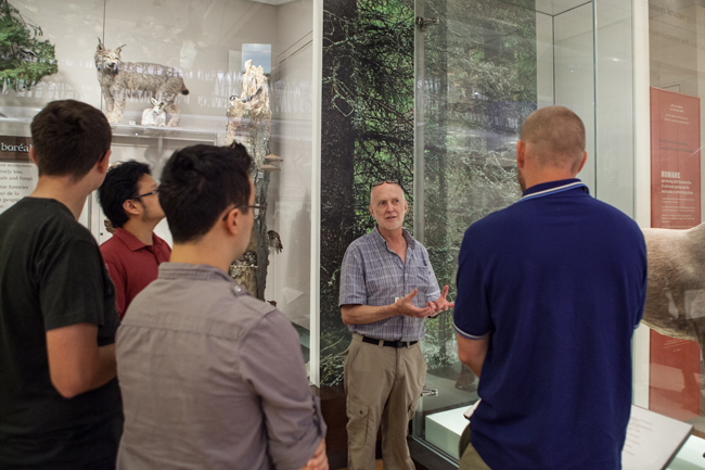 ROM Curator Doug Currie explains an exhibit in the Schad Gallery of biodiversity to a group of Game Jam participants.