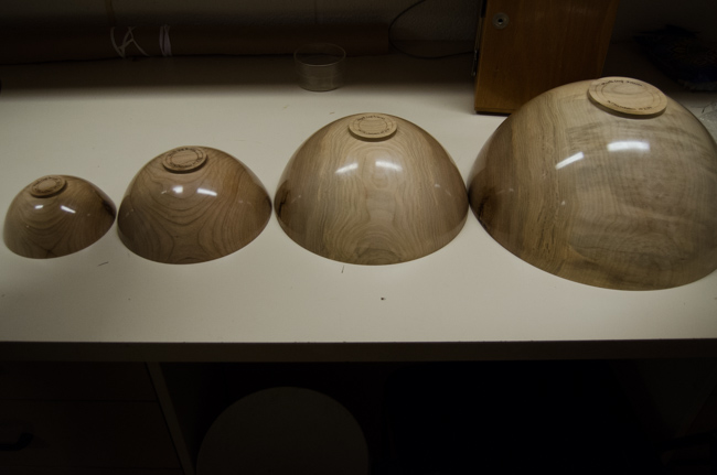 The finished set of nesting bowls unpacked and aligned on a table at the ROM. Photo by Justine DiCesare