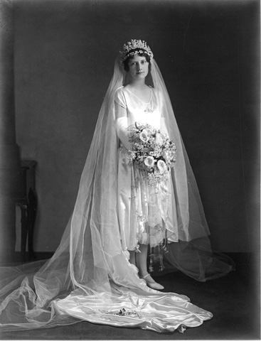 Portrait of bride dressed in white wedding gown.