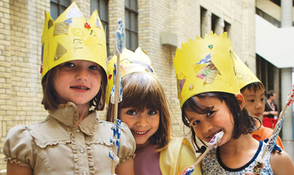Girls wearing crowns they have made at the ROM.