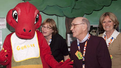 Volunteers with Gertie, ROM's youngest dino mascot.