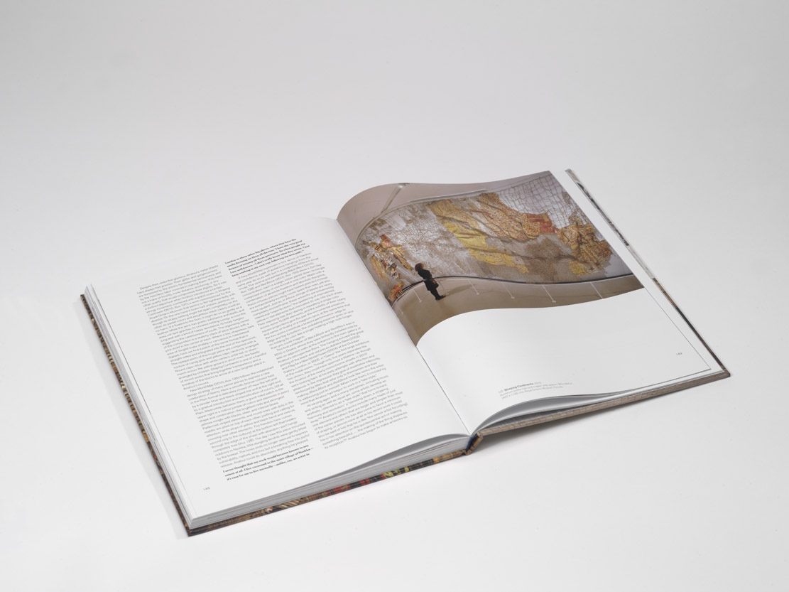 El Anatsui: Art & Life by Susan Vogel open at page 149 to show ROM image of 2010.44.1.1-8 Straying Continents