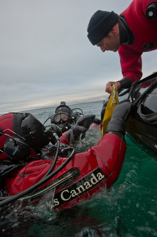 Parks Canada archaeologists diving the wreck of the HMS Investigator