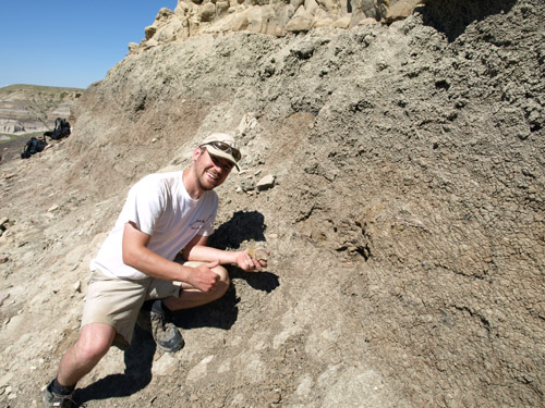Caleb Brown with his discovery of Acrotholus in 2008. Photo: Derek Larson, © ROM