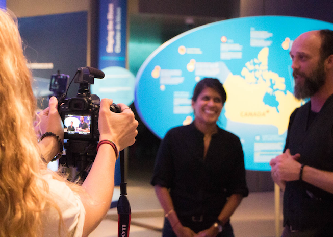 Asha de Vos and Dave Ireland are interviewed at the Out of the Depths: The Blue Whale Story Exhibit in May, 2017. Photo Credit: Meghan Callon
