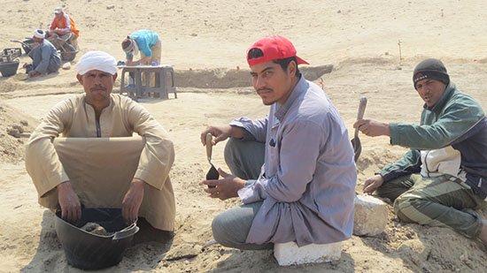 Workers from Dr. Kemps team pose with archaelogical tools.  © Laura Ranieri