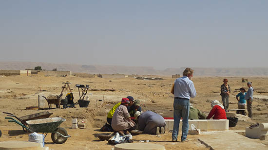 Archaeological site with team at work.