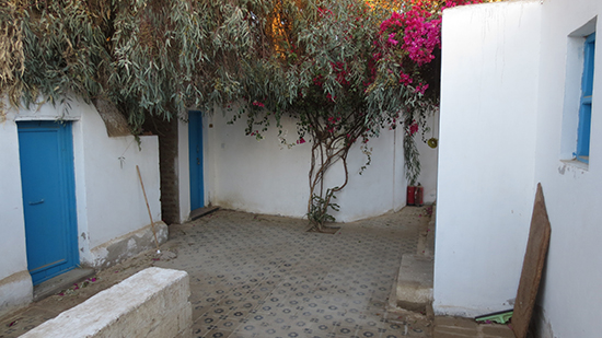 A courtyard with a mosaic floor.