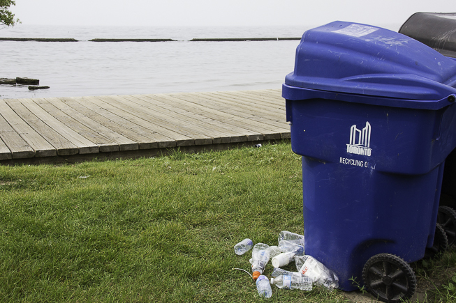 A recycle bin overflows on the beach in Toronto's west-end. Photo credit: Cristina Bergman