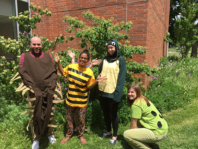 a group from the Biodiversity Institute of Ontario in Guelph pose with some costumes outside their building. Photo courtesy of Angela Telfer