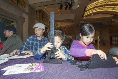 Families building lego at the ROM