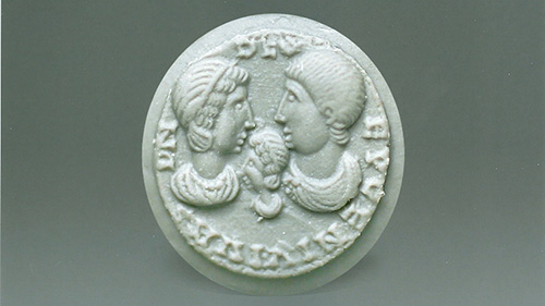 Portraits depicted on seal are embossed on the clay impression.