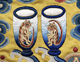 Image of cups with tigers depicted on them.