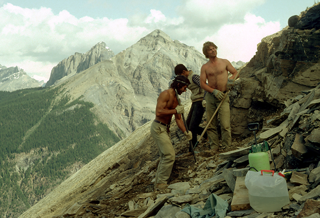 Photo of people digging fossils on the side of a mountain