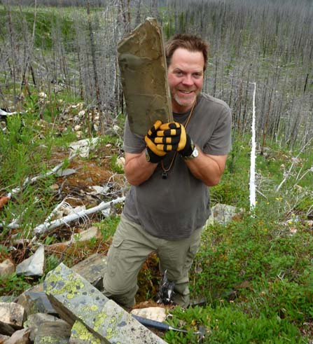 Robert Gaines discovers fossils along the rocky talus slope.
