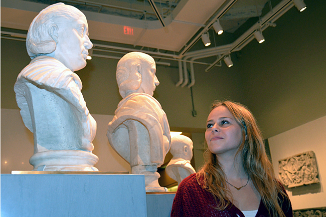 Clare Schwartzberg gazing at portrait busts
