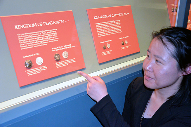 Menghan Yan pointing at silver cistophoric coins