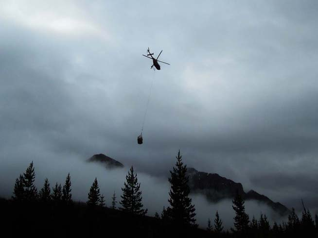 Helicopter transport of equipment in nets to the campsite (image courtesy of Gabriela Mangano)