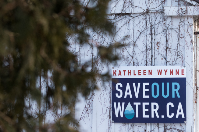 "A sign reads ""Kathleen Wynne SAVEOURWATER.CA"""