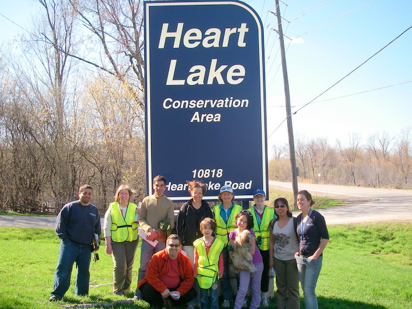 A group of people working together to protect wetlands in the Heart Lake Conservation Area