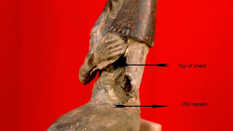 Image of the torso showing old repairs to the artifact.