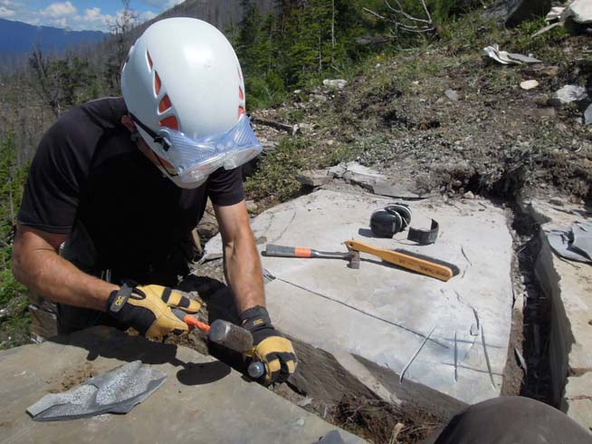 Extracting cut blocks using a hammer and chisel at the Stepehn Formation near Marble Canyon (image courtesy of Robert Gaines).