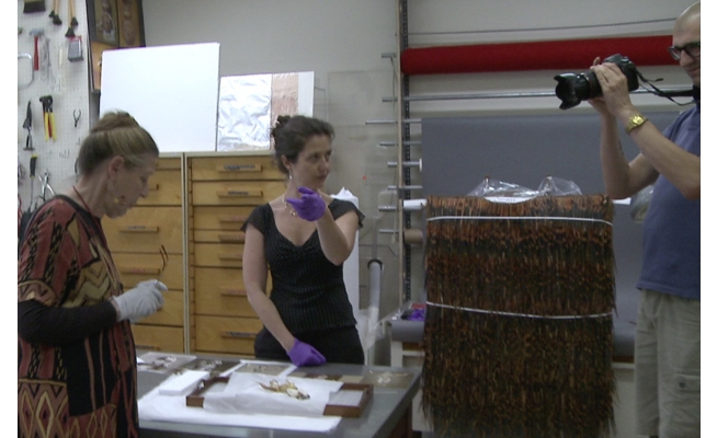 Julia Fenn and Kate being filmed by Zak Rogers in the ROM Conservation department
