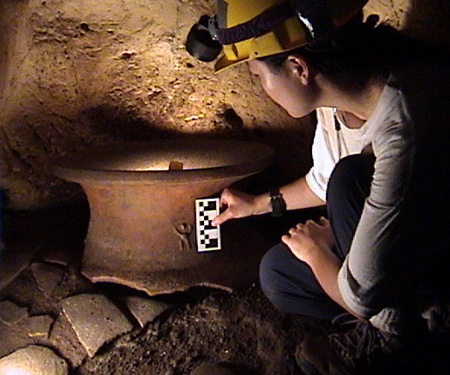 Kay takes a closer look at small decoration on the artifact.