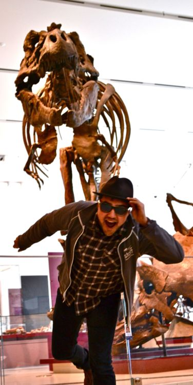 Kiron running away from the T-rex posed in the background.