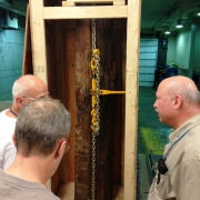 ROM Curator David Rudkin (L) and Technicians Peter Fenton (C), Brian Iwama (R) inspect the new acquisition