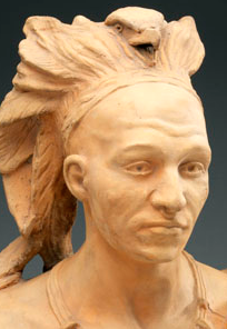 terracotta bust of a man wearing a feather headdress and necklace