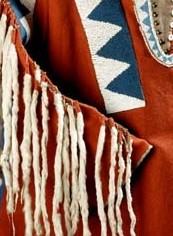 red shirt with blue and white beaded details and fringed sleeves