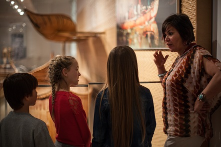a teacher instructs children in the first peoples' gallery